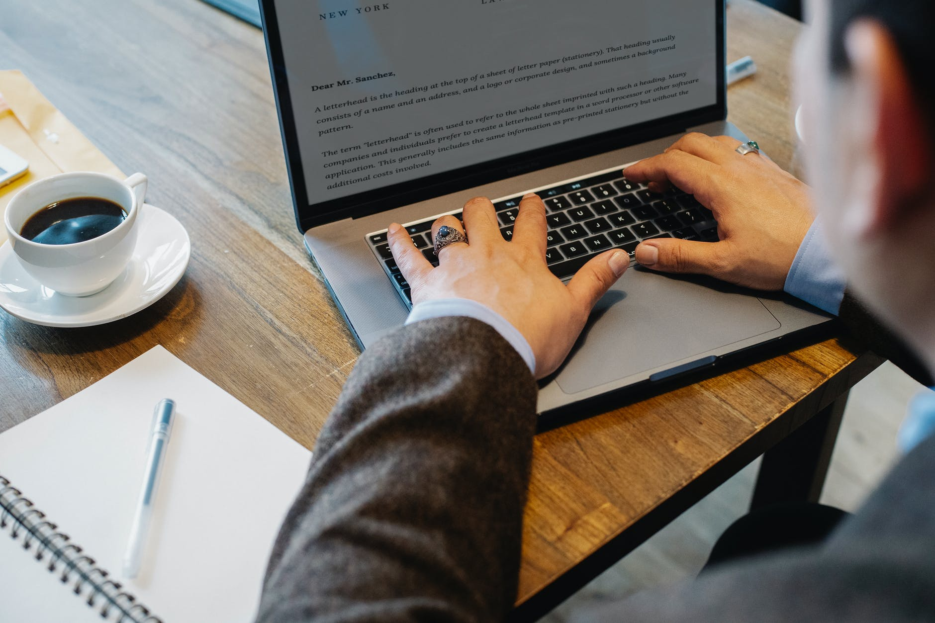 crop man typing on laptop in office